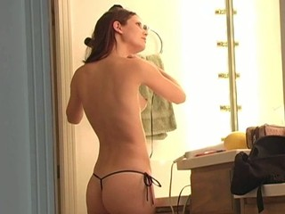 Longhaired honey is inserting banana in her luscious twat