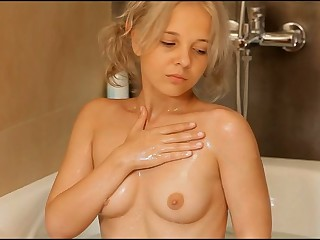 Sexual nymph is showing delights before masturbating so well