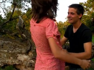 Lascivious teen honey bonks on a fallen treen outdoors with partner