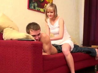 Captivating chick enjoys sex on the red couch with her partner
