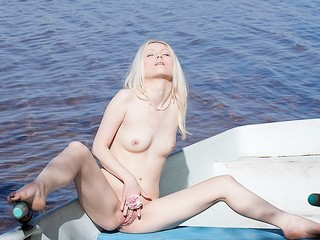 What can a gorgeous golden-haired do all alone in a boat in the centre of a lake? Check out in this steamy art porn clip!